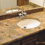 Single bowl vanity top with beveled edge with a biscuit porcelain under mount sink