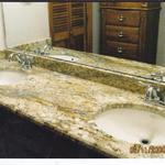 Double bowl vanity top with beveled edge with biscuit colored porcelain under mount sinks